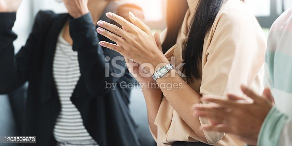 1180918029 istock photo Close up Group of People applauding in a meeting. Businessman, Businesswoman in a conference. 1208509673