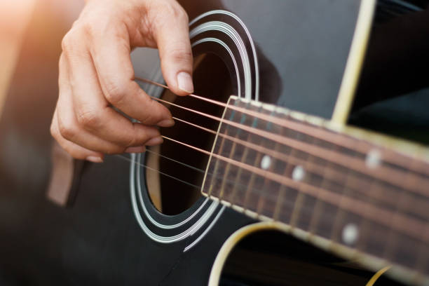 Close up. Guitarist on stage for background, Men hands playing acoustic guitar. Close up. Guitarist on stage for background, Men hands playing acoustic guitar. guitarist stock pictures, royalty-free photos & images