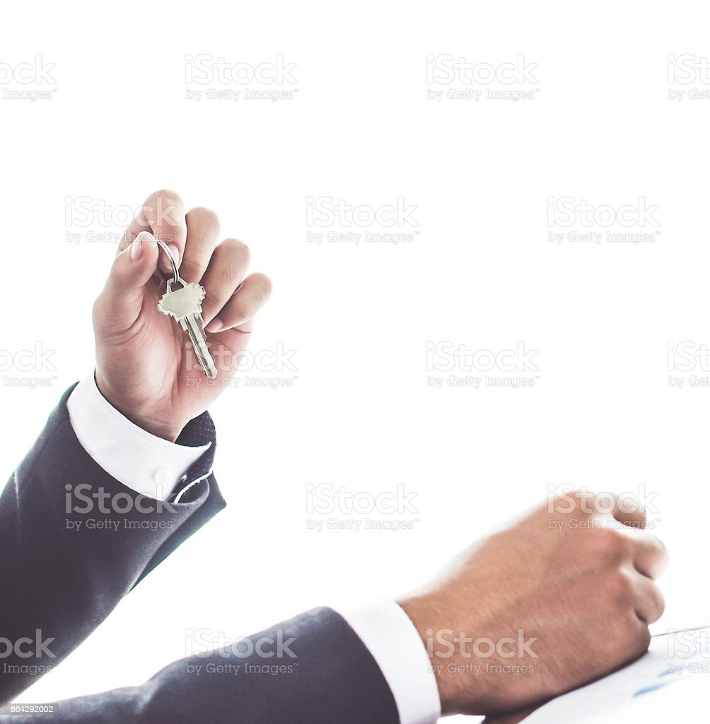 Close up. hand Asia businessman holding office key on white background royalty-free stock photo