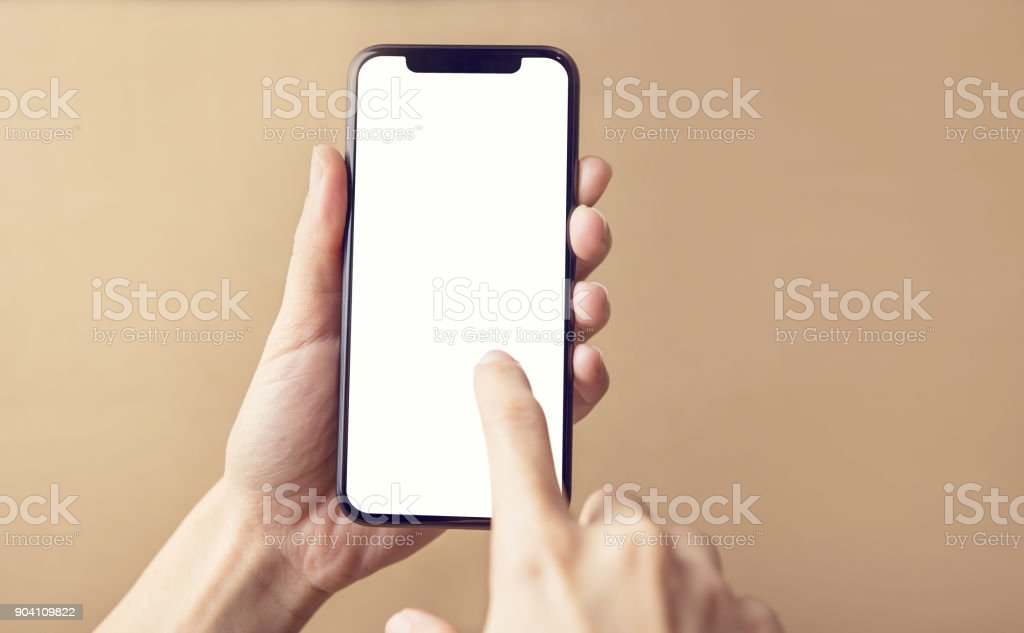 Close up hand holding black smartphone on white clipping path inside stock photo