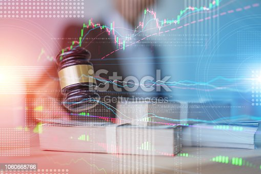 istock close up hand lawyer with wooden auction judge hammer with money blur background 1060668766