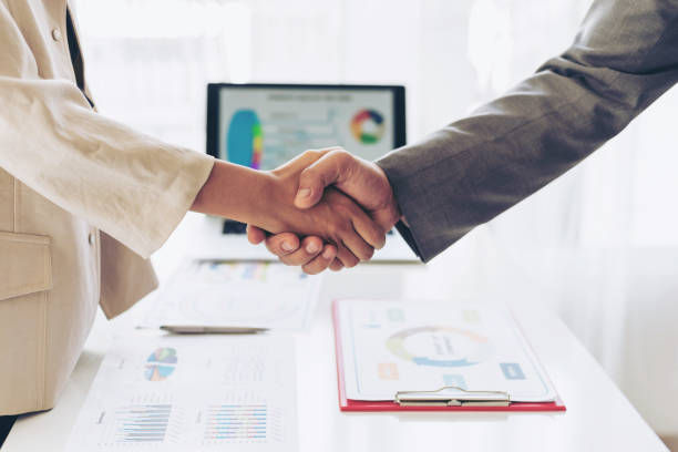 close up hand of business  people shaking hands finishing up meeting showing unity , business teamwork concept stock photo