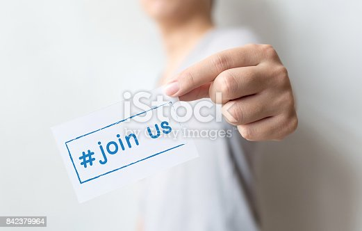 istock Close up hand of casual man holding white card with text hashtag join us, Concept job recruitment and human resource 842379964