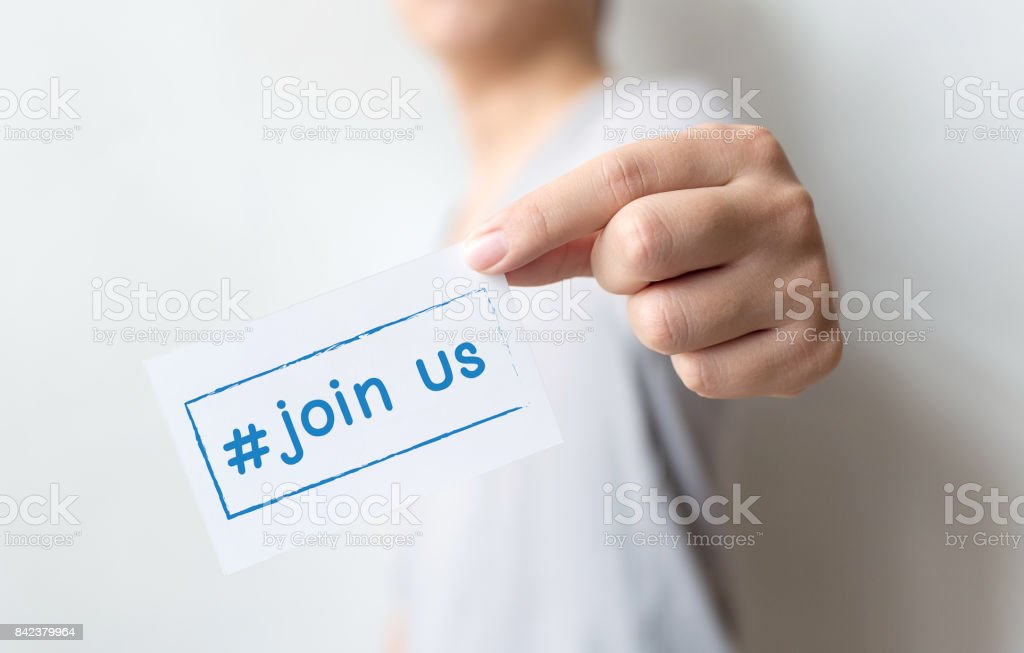 Close up hand of casual man holding white card with text hashtag join us, Concept job recruitment and human resource stock photo