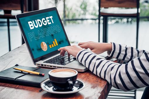 Close up hand of influencer budget planning for online media advertising at cafe restaurant.online marketing concept