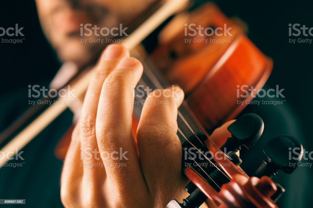 Close up hand of violinist playing. stock photo