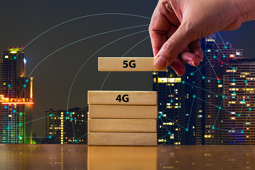 istock Close up hand putting domino 5G under 4G .That showing developed of best internet connection 5G is network connecting technology future global change from 4G to 5G system concept. 1164249689