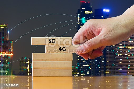 istock Close up hand putting domino 5G under 4G .That showing developed of best internet connection 5G is network connecting technology future global change from 4G to 5G system concept. 1164249695