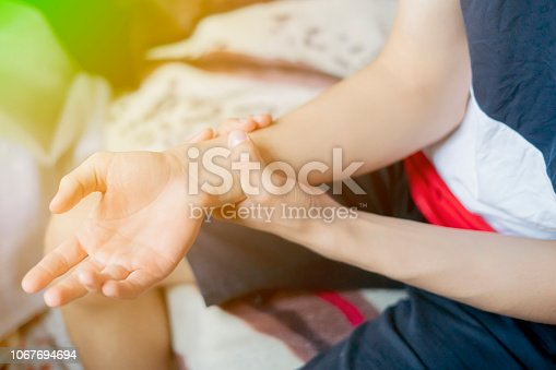 istock close up hand touch arm feeling pain f 1067694694