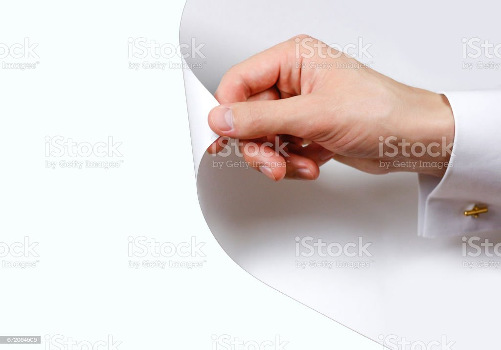 Close up hand turn white page. Turning the page from white to white background. Isolated stock photo
