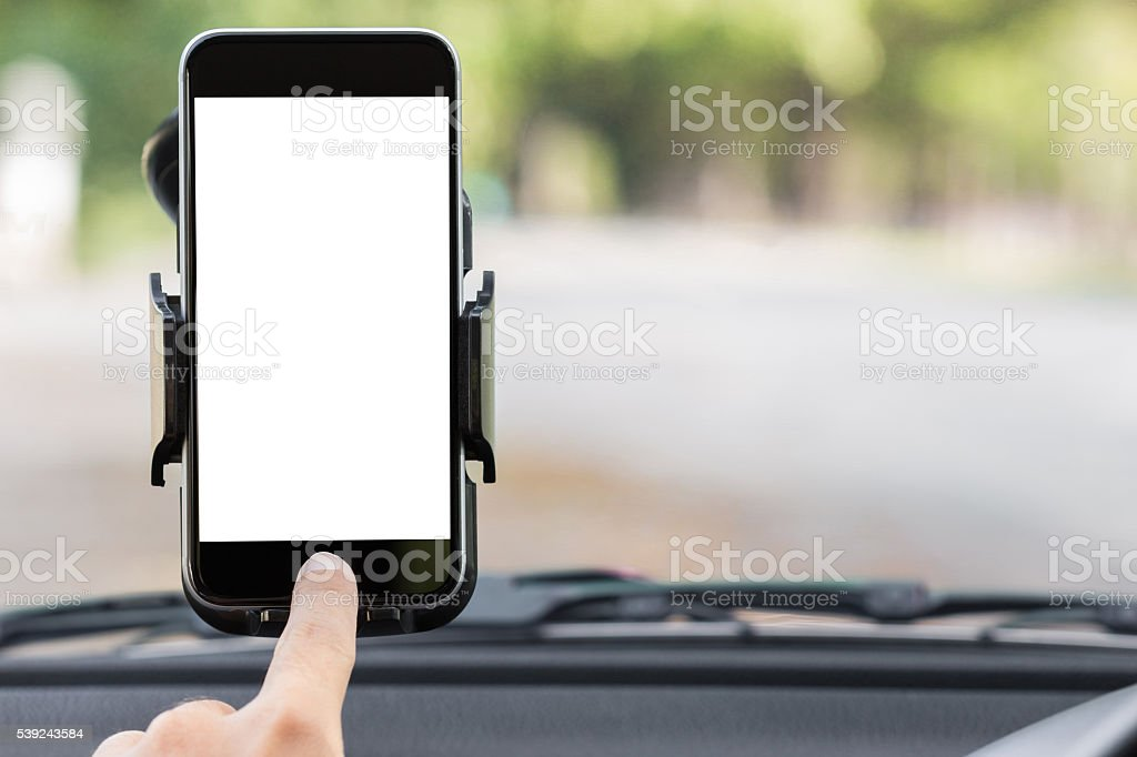 close up hand use phone on mount in car stock photo