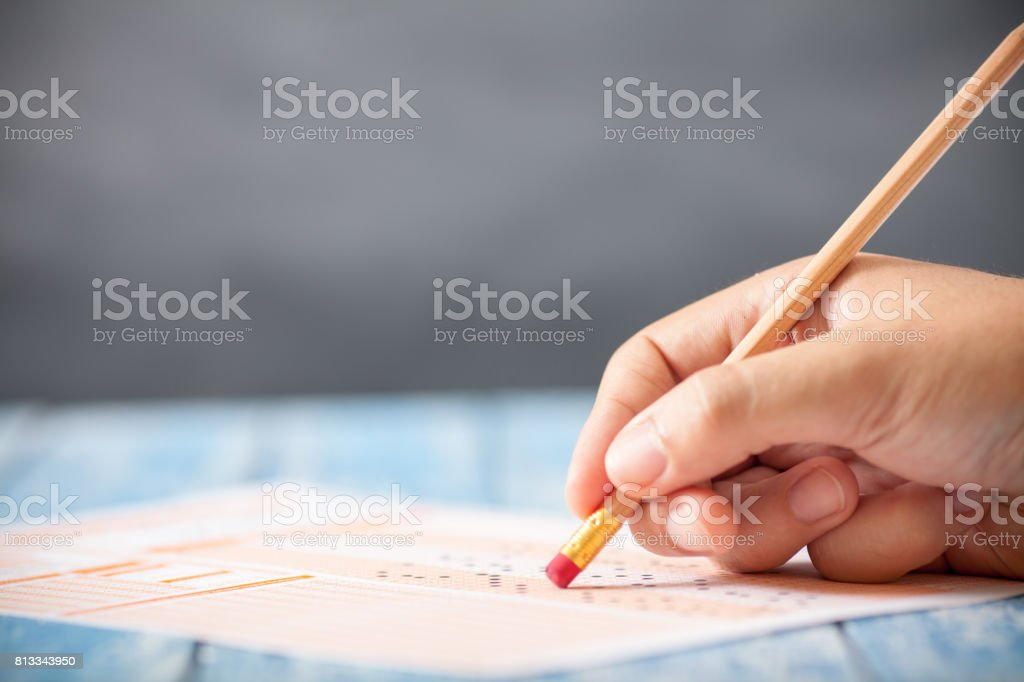 Close up hand with pencil on answer sheet stock photo