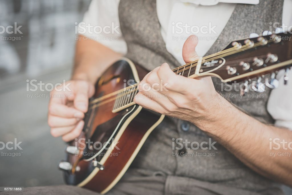 close up hands hipster man playing mandolin stock photo