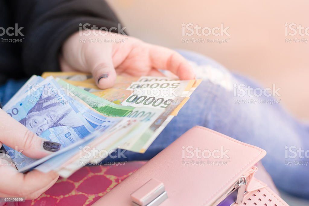 Close Up hands of casual woman counting money stock photo