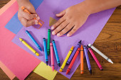istock Close up hands of child drawing with colorful crayons 182930182