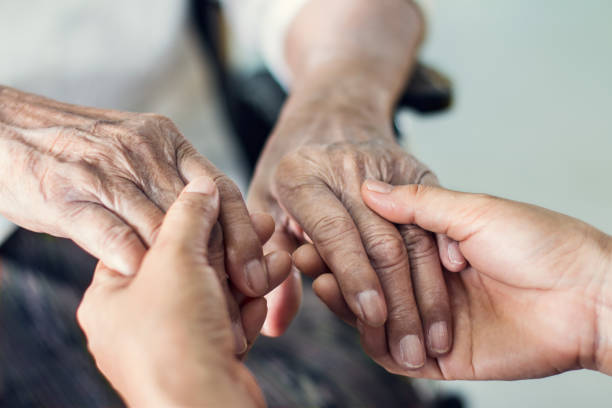 close up hands of helping hands elderly home care. mother and daughter. mental health and elderly care concept - geriatrics stock pictures, royalty-free photos & images
