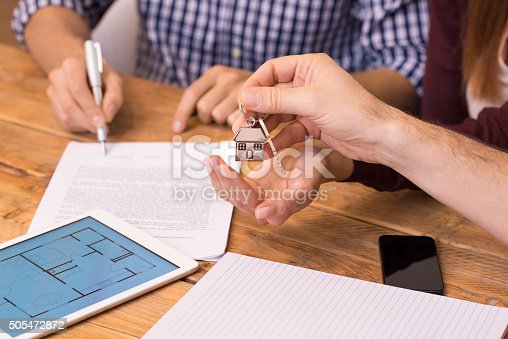 istock Close up hands receiving house keys 505472872