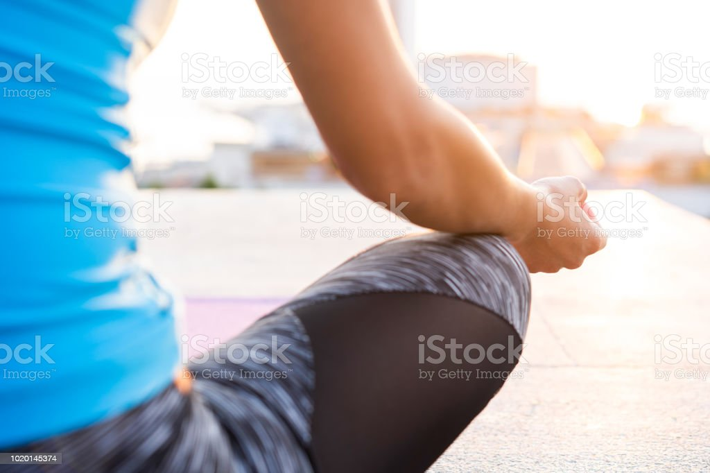 Close up hands. Woman do yoga outdoor. Woman exercising vital and...