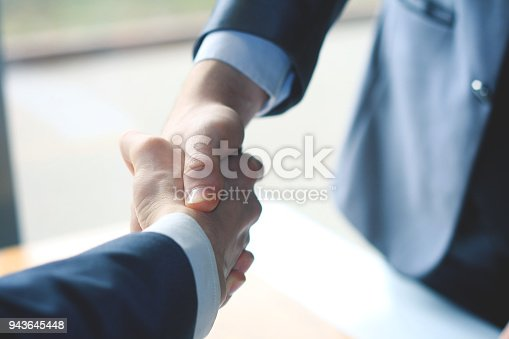 istock close up. handshake business partners on blurred background 943645448