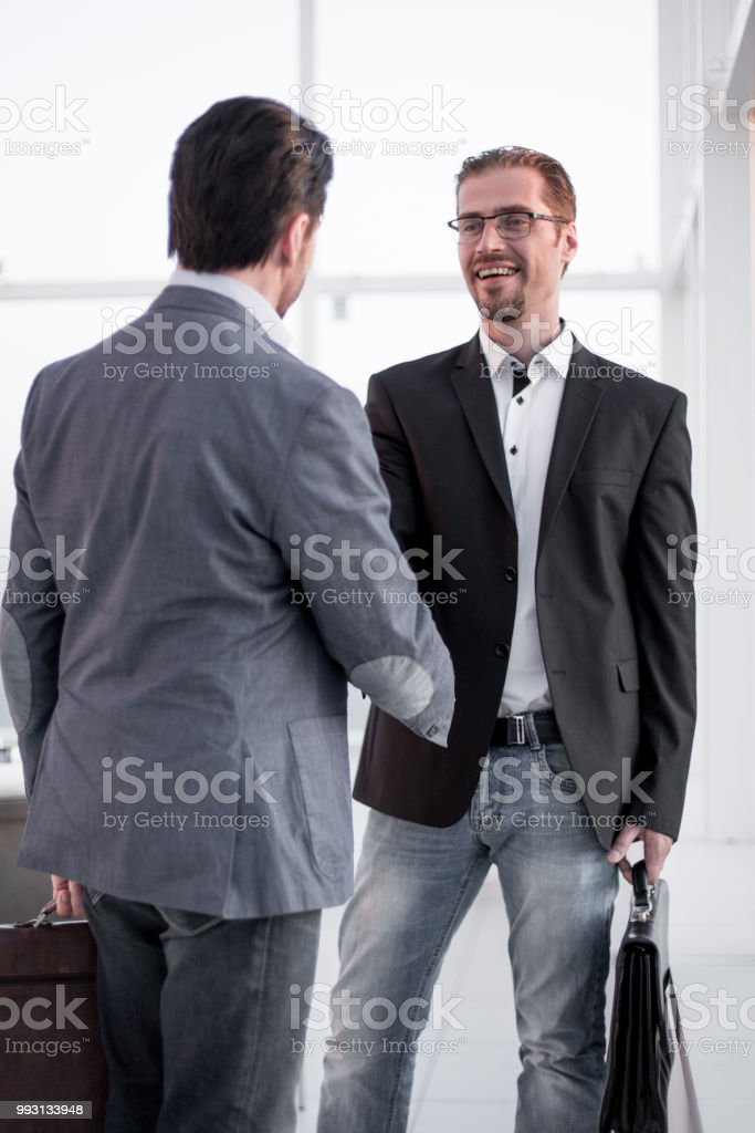 close up. handshake business people in the lobby stock photo