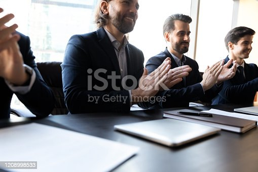 509032417 istock photo Close up happy clap hands businessmen with applicant cv. 1208998533