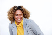 istock Close up happy young african american woman laughing with jacket against isolated white background 1137796438