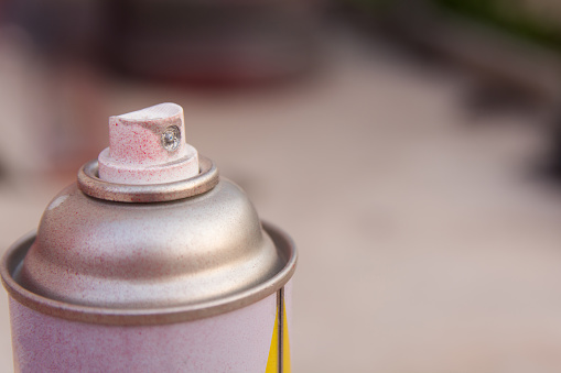 close up head aluminum spray paint can. with copy space
