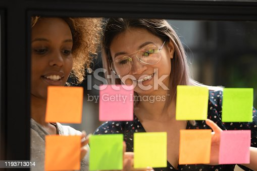1144569896 istock photo Close up head shot smiling multiracial colleagues working at office. 1193713014