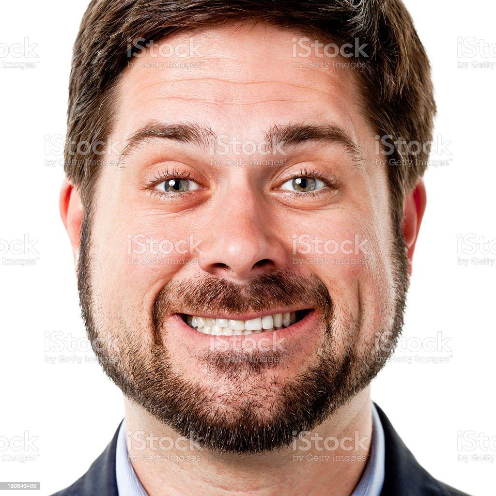 Close Up Headshot Of Man With Cheesy Grin stock photo