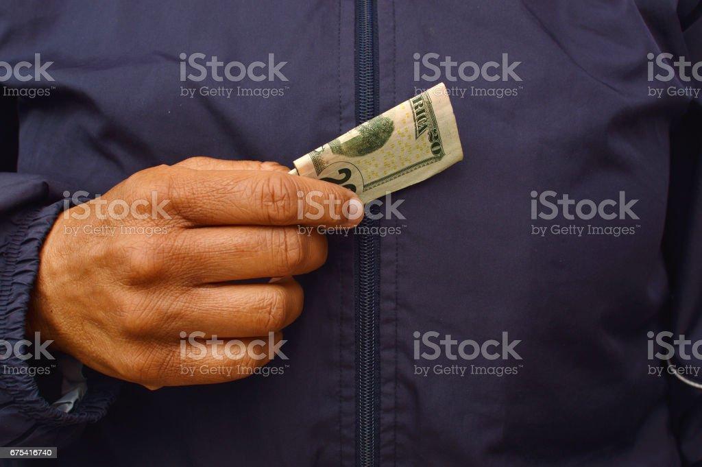 Close up holding twenty dollar bill stock photo