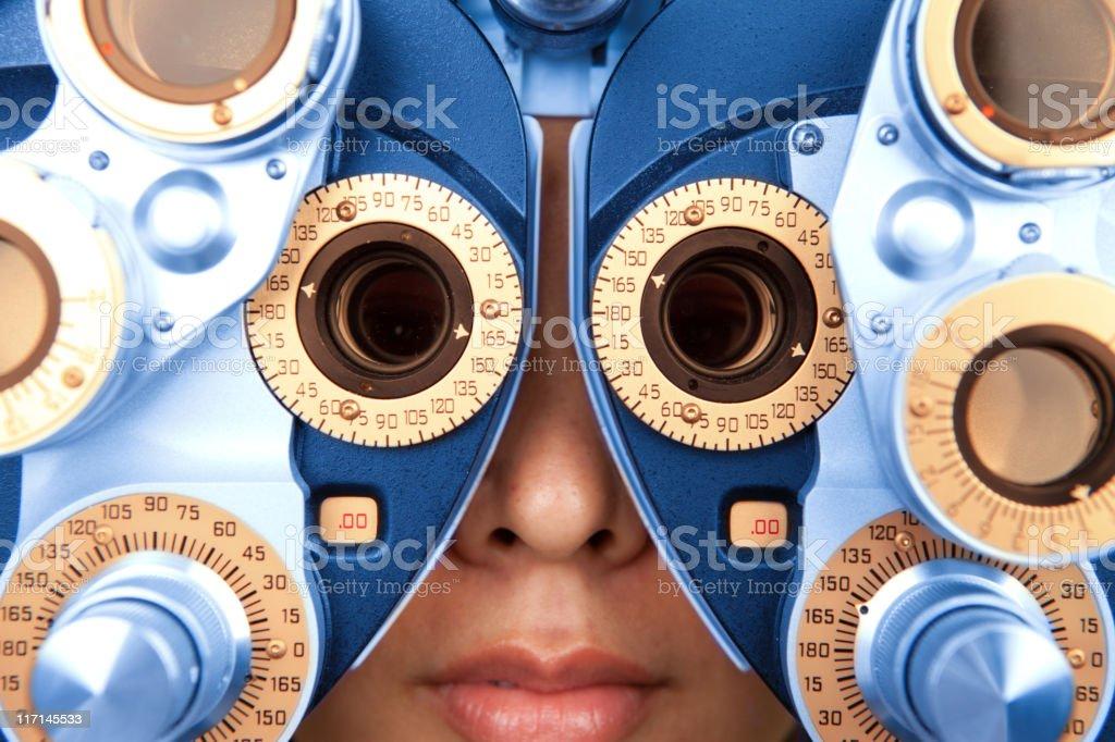 close up horizontal of optometry machine blue and orange stock photo