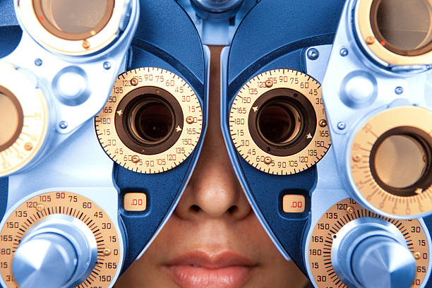 close up horizontal of optometry machine blue and orange - optometrist stock pictures, royalty-free photos & images