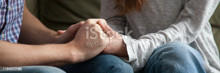 Close up horizontal photo of couple in love holding hands loving wife supporting encouraging beloved husband show express sympathy. Understanding in relations concept banner for website header design