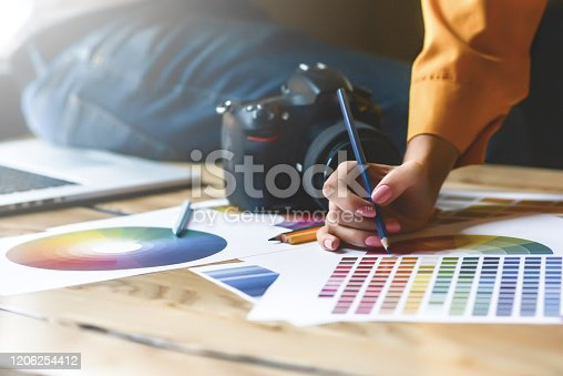 923634538 istock photo Close up hoto of Interior designers teamwork with house building plans on office desk, architects working with many-color palette to choose best color for design 1206254412