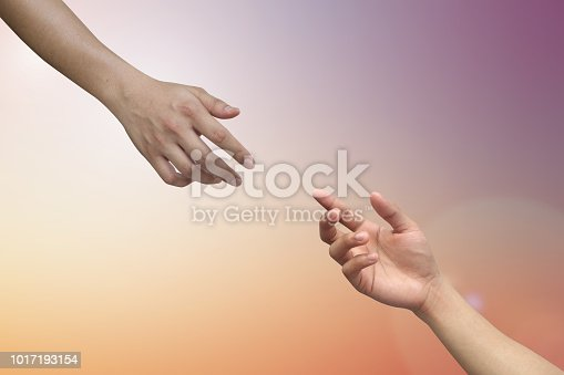 istock close up human hand receiving or blessing something with god hand outstretch for helping on blurred colorful sunrise sky for religion and believe concept 1017193154