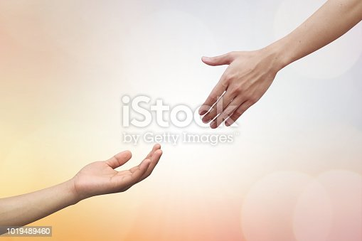 istock close up human hand receiving or blessing something with god hand outstretch for helping on blurred colorful sunrise sky for religion and believe concept 1019489460
