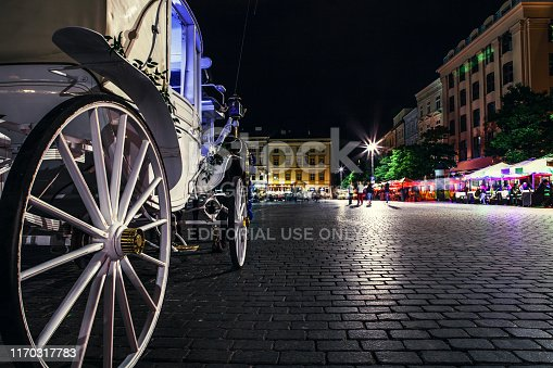 KRAKOW, POLAND - DECEMBER 12 2015: Close up image carriage wheel on main square of of city in Krakow,Poland