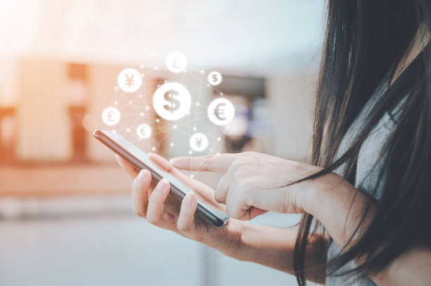 close up image hand using mobile phone with online transaction application, concept financial technology (fintech) and ico initial coin offering business financial internet innovation technology - exchange rate stock pictures, royalty-free photos & images