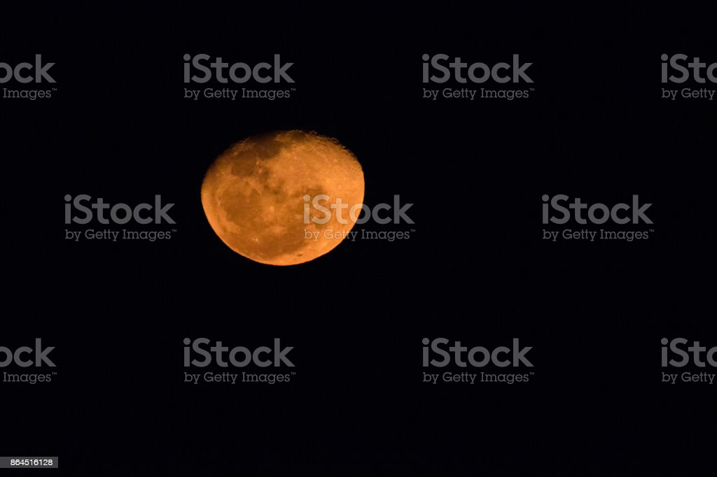 Close up image of  a blood moon in the dark sky in South Africa stock photo