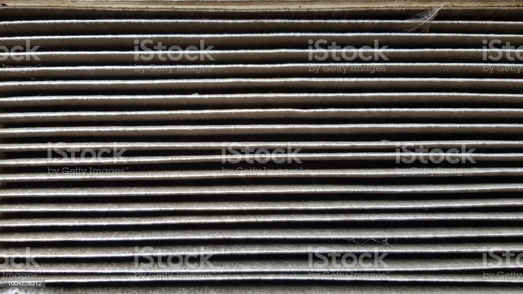 Close up image of a dirty air filter stock photo