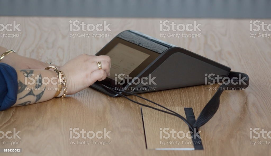 Close up image of a New Zealand business woman in the office using a conference machine. stock photo