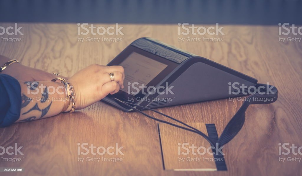 Close up image of a New Zealand business woman in the office using a conference machine - haze effect. stock photo