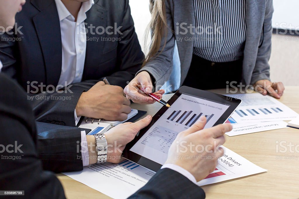 Close up image of business team discussing the data stock photo
