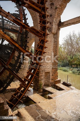 Close up image of historic water wheels in Hama, Syria These are large mechanical wooden wheels called norias. They take water from orontes river and canalise it to irrigation.