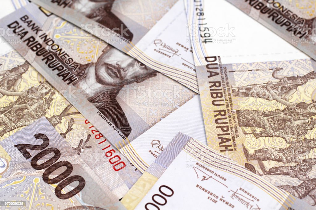 A close up image of Indonesian 2000 rupiah notes stock photo