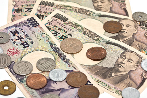 Close up image of Japanese Yen on a white background stock photo