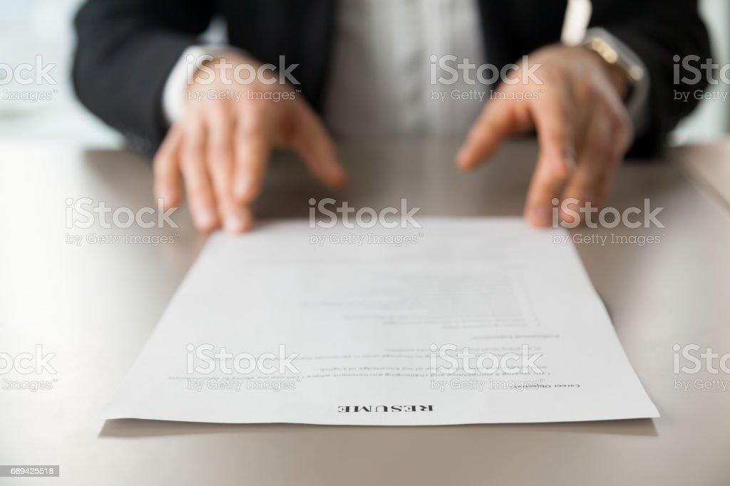 Close up image of resume at desk of employer stock photo