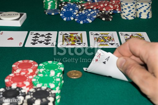 istock A close up image of stacked poker chips and a royal flush. A textured background.Copy paste place 886131372