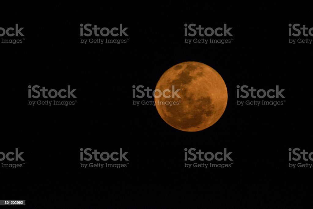 Close up image of the blood moon in the dark sky in South Africa stock photo