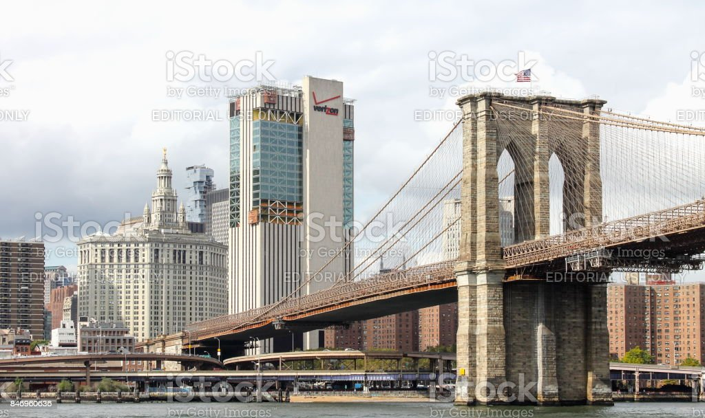 Close up image of the Brooklyn Bridge from the East River with Manhattan in the background. stock photo